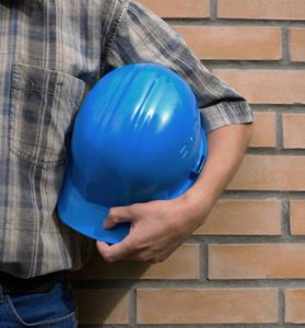 Masonry Contractor Holding hard hat