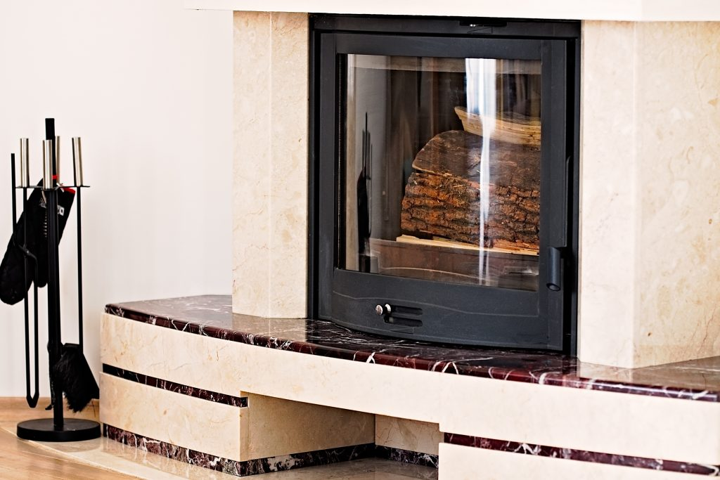 Firewood glass doors surrounding a modern fireplace